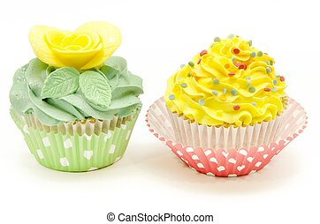 Cupcakes decorated with butter cream and flowers