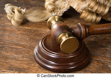 Wig and gavel - Wooden block, judge's wig and gavel on a...