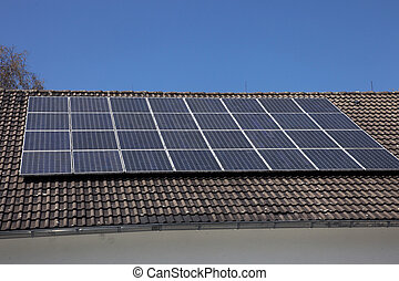 Solar panels on a house roof - An array of photovoltaic...