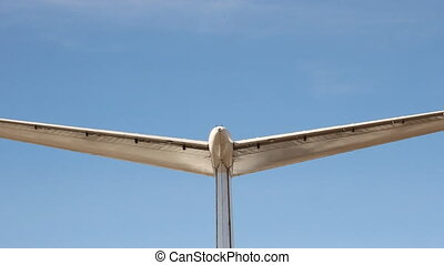 The tail of the plane on a background of blue sky