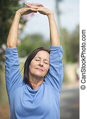 Happy relaxed mature woman arms up - Portrait attractive...