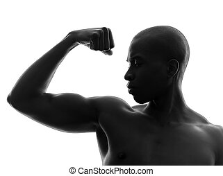 african black man flexing muscle silhouette - one african...