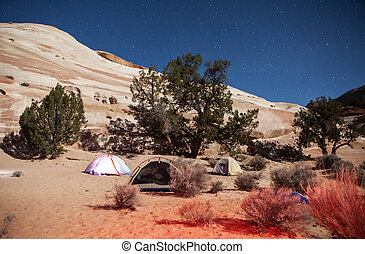 Nighttime Camping - Backpacker tents under a starry sky at...