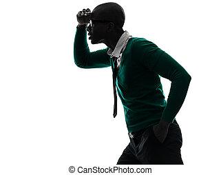 african black man looking away worried silhouette - one...
