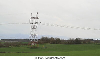 rising to the tower - Workers in electrical tower