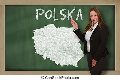 Teacher showing map of polska on blackboard - Successful,...