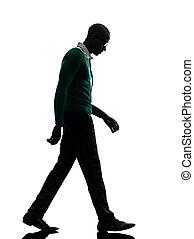 african black man walking looking down sad silhouette - one...