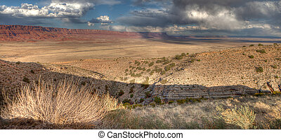 Vermillion Cliffs - Storm clouds loom over the Vermillion...