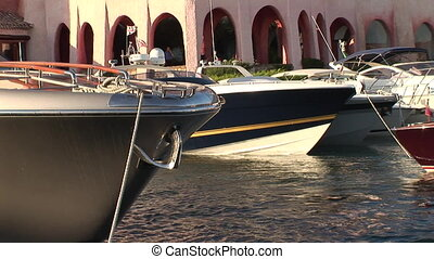 Luxury boats docked at a harbour - Luxury boats docked at a...