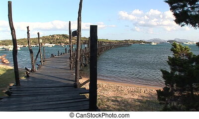 Rustic wooden pier on the Mediterranean sea