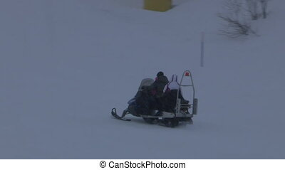 Snowmobile running on the snow