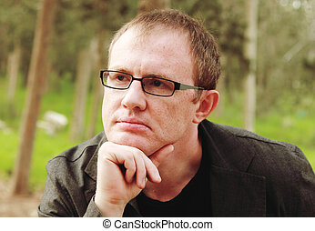handsome 35 years old man with glasses outdoors