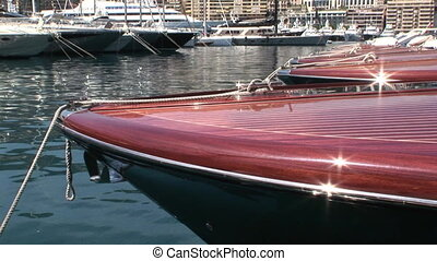 Bows of docked wooden boats - Bows of docked wooden Riva...