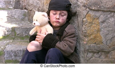 Homeless poor little boy