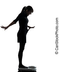 woman standing on weight scale happy silhouette - one woman...