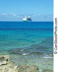 Approaching cruise - White cruise ship approaching coast in...