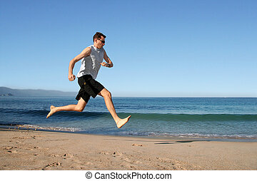 man running on the beach - Barefooted man running on the...