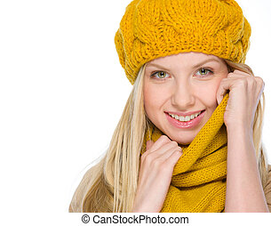 Portrait of smiling girl in autumn clothes