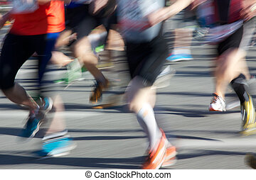 Marathon Runners - Legs of Marathoners blurred by their...
