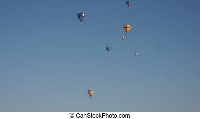 Image of many colorful hot air balloons in sky