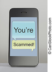 Mobile phone with scam message speech bubble - Mobile phone...