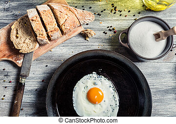 Fried egg on a cast iron frying pan