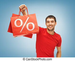 man with shopping bags - picture of handsome man with...