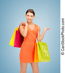 woman with shopping bags - picture of beautiful woman with...