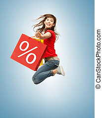 shopper - picture of jumping teenage girl with shopping bags