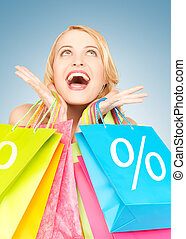 woman with shopping bags - picture of amazed woman with...