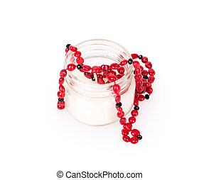 candle, coral beads isolated on white background