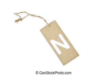 Brown paper tag with letter N cut