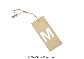 Brown paper tag with letter M cut