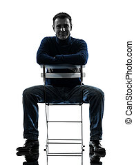 man sitting smiling looking at camera silhouette full length