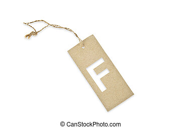 Brown paper tag with letter F cut