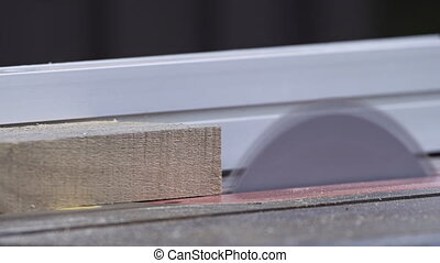 Ripping Board on Table Saw - Slow motion close shot of...