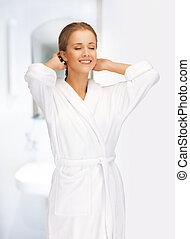 beautiful woman in white bathrobe