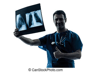 one caucasian man doctor surgeon radiologist medical thumb up examaning lung torso  x-ray image silhouette isolated on white background