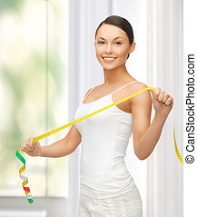 sporty woman with measuring tape - picture of sporty woman...