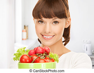 woman in the kitchen with tomatoes