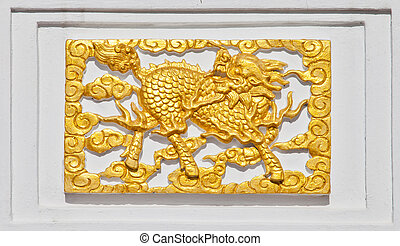 Golden Dragon on temple wall