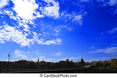 blue sky with clouds silhouette of city