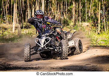 ATV racer takes a turn during a race. - ATV racer takes a...