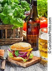 Homemad hamburger and a cold beer