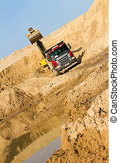 Excavator at Work - Excavator Loading Dumper Truck