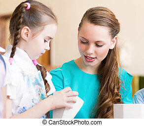teacher talks to a schoolgirl