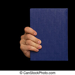 blue book in hand on a black background