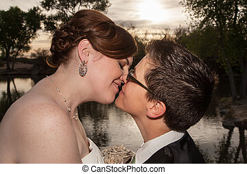 Kissing Married Gay Couple - Two kissing newlywed lesbians...