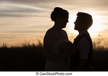 Loving Gay Couple - Gay couple married in front of beautiful...