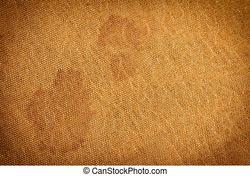 Background of golden fabric with stains. texture